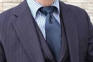 Tailored dark blue pinstriped suit.