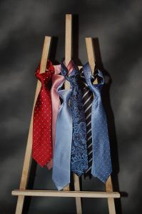 Ties tied up and hanging off an artists etsal